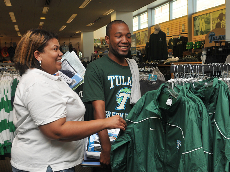 A mom helps her son shop for some Tulane apparel.